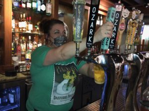 Postmasters Grill employee serves up draft beer